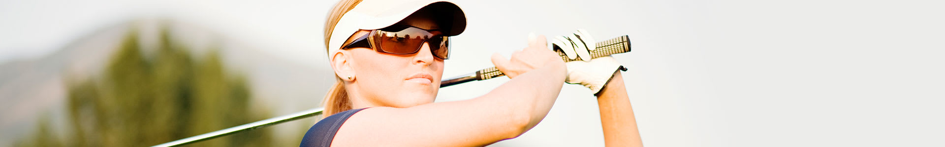 Woman Golfing with Sunglasses